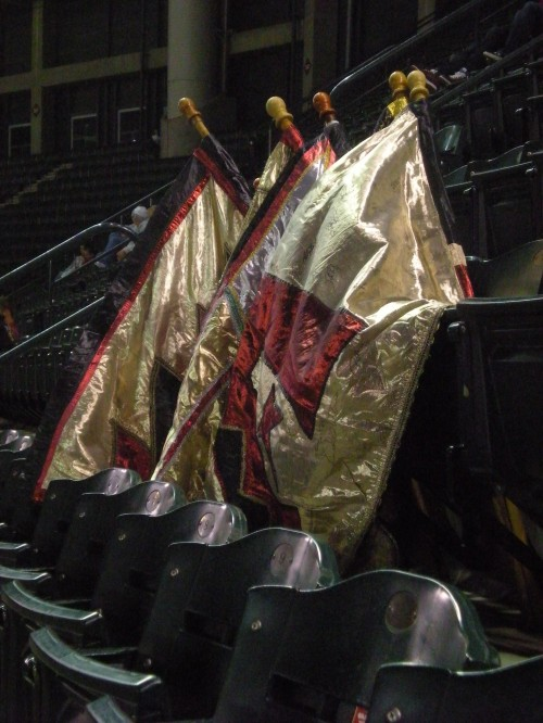 McBride's flags rest on the upper-level seats at Chase Stadium in Phoenix.