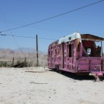 An abandoned trailer, decades old, that someone had painted completely pink, tires included.